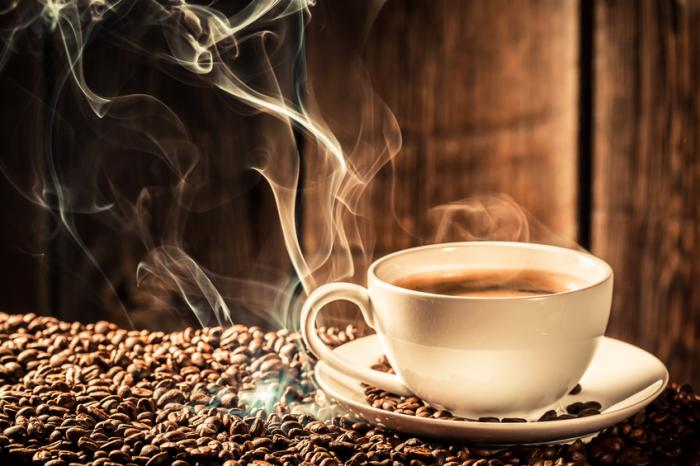 a-cup-of-hot-coffee-with-coffee-beans